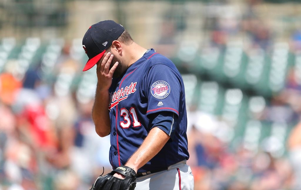 . Minnesota Twins starting pitcher Lance Lynn wipes his face after being relieved during the seventh inning of a baseball game against the Detroit Tigers, Thursday, June 14, 2018, in Detroit. (AP Photo/Carlos Osorio)