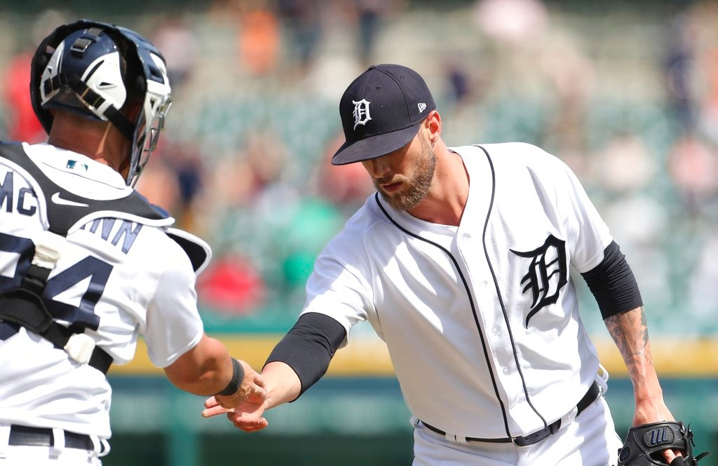 . Detroit Tigers relief pitcher Shane Greene shakes hands with catcher James McCann after the ninth inning of a baseball game against the Minnesota Twins, Thursday, June 14, 2018, in Detroit. (AP Photo/Carlos Osorio)