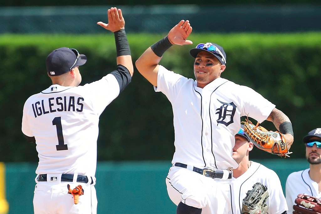 . Detroit Tigers shortstop Jose Iglesias (1) and center fielder Leonys Martin celebrate the team\'s 3-1 win over the Minnesota Twins in a baseball game, Thursday, June 14, 2018, in Detroit. (AP Photo/Carlos Osorio)