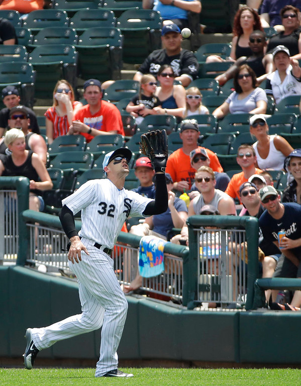 . Chicago White Sox right fielder Tracy Thompson catches a fly ball by Detroit Tigers\' John Hicks during the first inning of a baseball game in Chicago, Sunday, June 17, 2018. (AP Photo/Nam Y. Huh)