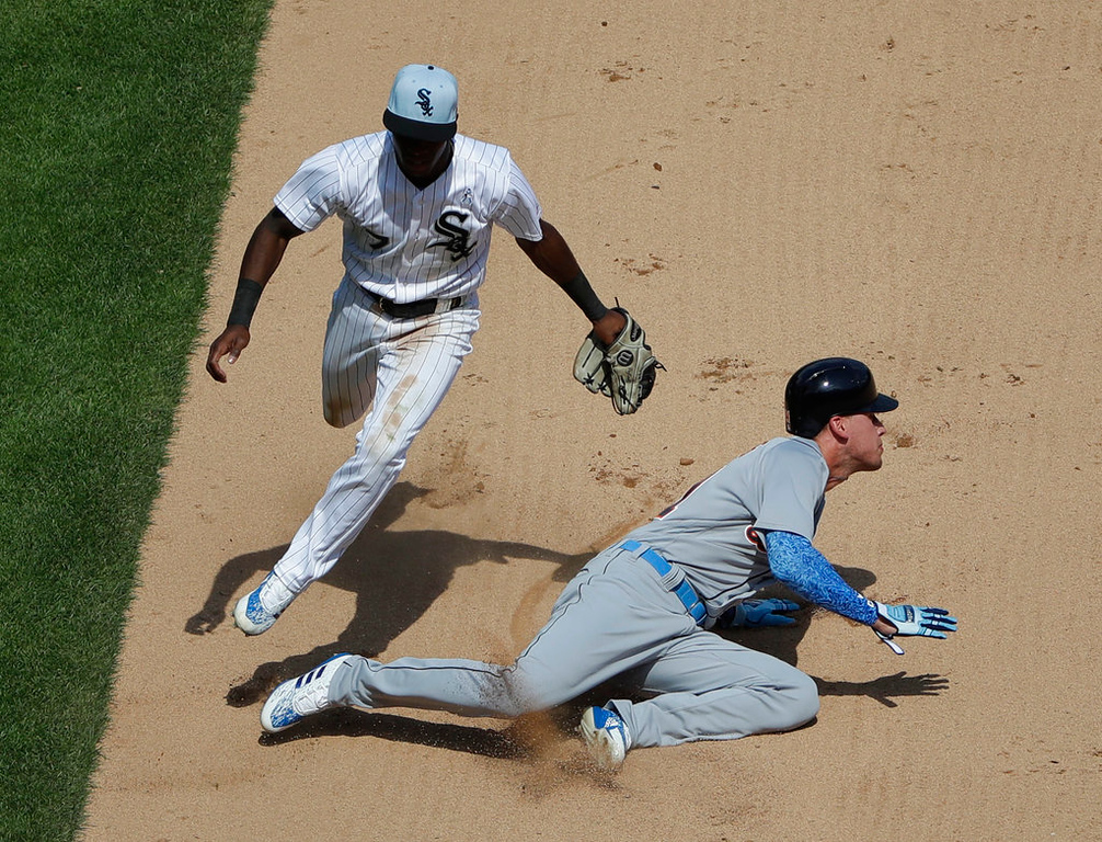. Detroit Tigers\' JaCoby Jones, right, is tagged out by Chicago White Sox shortstop Tim Anderson after being picked off on a steal-attempt of second base during the seventh inning of a baseball game in Chicago, Sunday, June 17, 2018. (AP Photo/Nam Y. Huh)