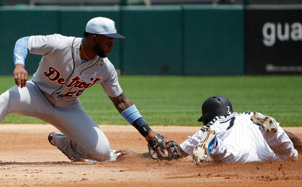 . Detroit Tigers second baseman Niko Goodrum, left, tags out Chicago White Sox\'s Tim Anderson at second during the first inning of a baseball game in Chicago, Sunday, June 17, 2018. (AP Photo/Nam Y. Huh)