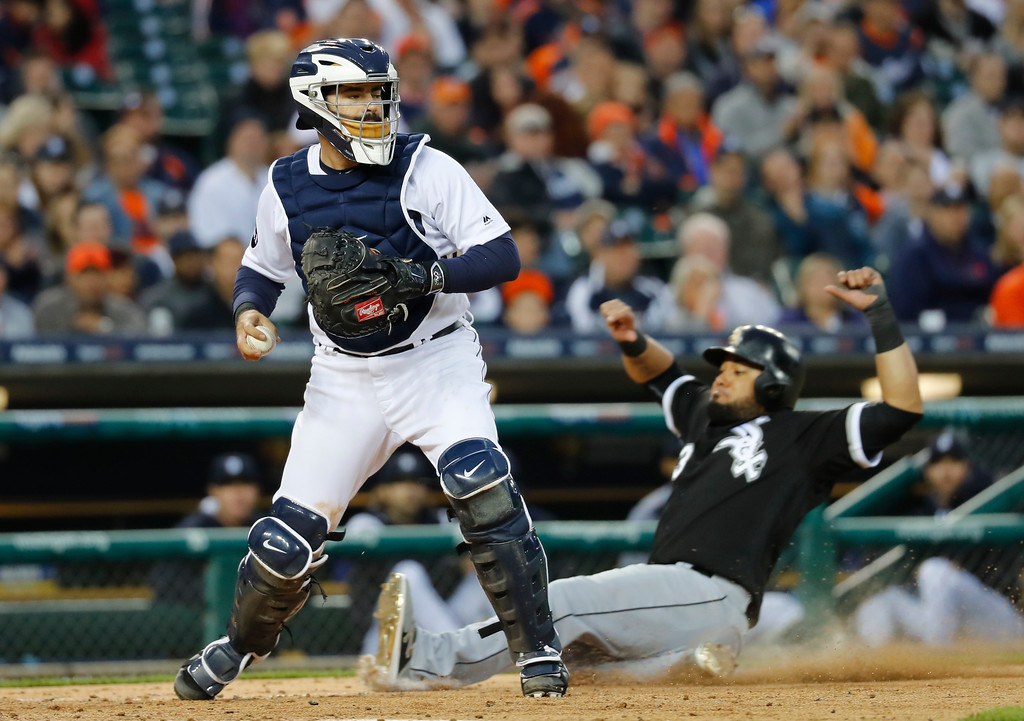 . Detroit Tigers catcher Alex Avila tags home plate on a force out as Chicago White Sox\'s Melky Cabrera slides in the third inning of a baseball game in Detroit, Friday, April 28, 2017. (AP Photo/Paul Sancya)