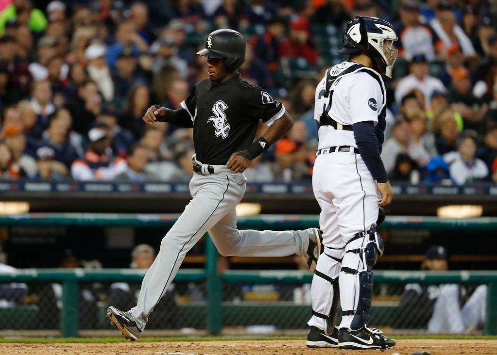 . Chicago White Sox\'s Tim Anderson scores on a Avisail Garcia single against the Detroit Tigers in the third inning of a baseball game in Detroit, Friday, April 28, 2017. (AP Photo/Paul Sancya)