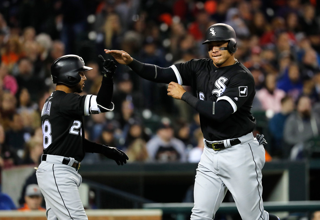 . Chicago White Sox\'s Avisail Garcia, right, celebrates scoring with Leury Garcia (28) on a Geovany Soto two-run single against the Detroit Tigers in the eighth inning of a baseball game in Detroit, Friday, April 28, 2017. (AP Photo/Paul Sancya)