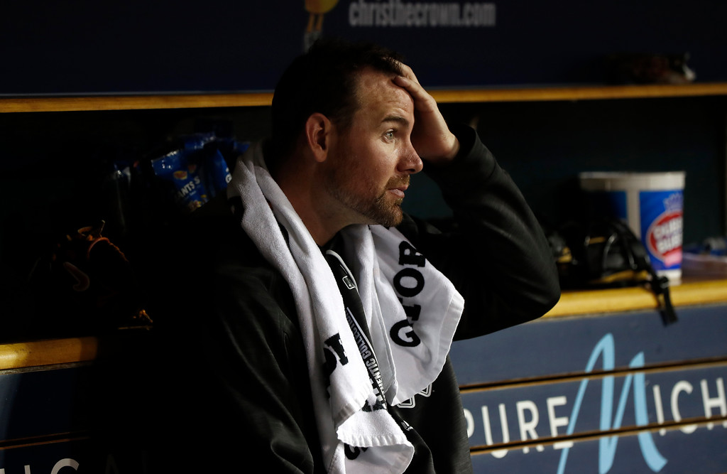. Chicago White Sox pitcher Mike Pelfrey watches from the bench after being pulled against the Detroit Tigers in the fifth inning of a baseball game in Detroit, Friday, April 28, 2017. (AP Photo/Paul Sancya)