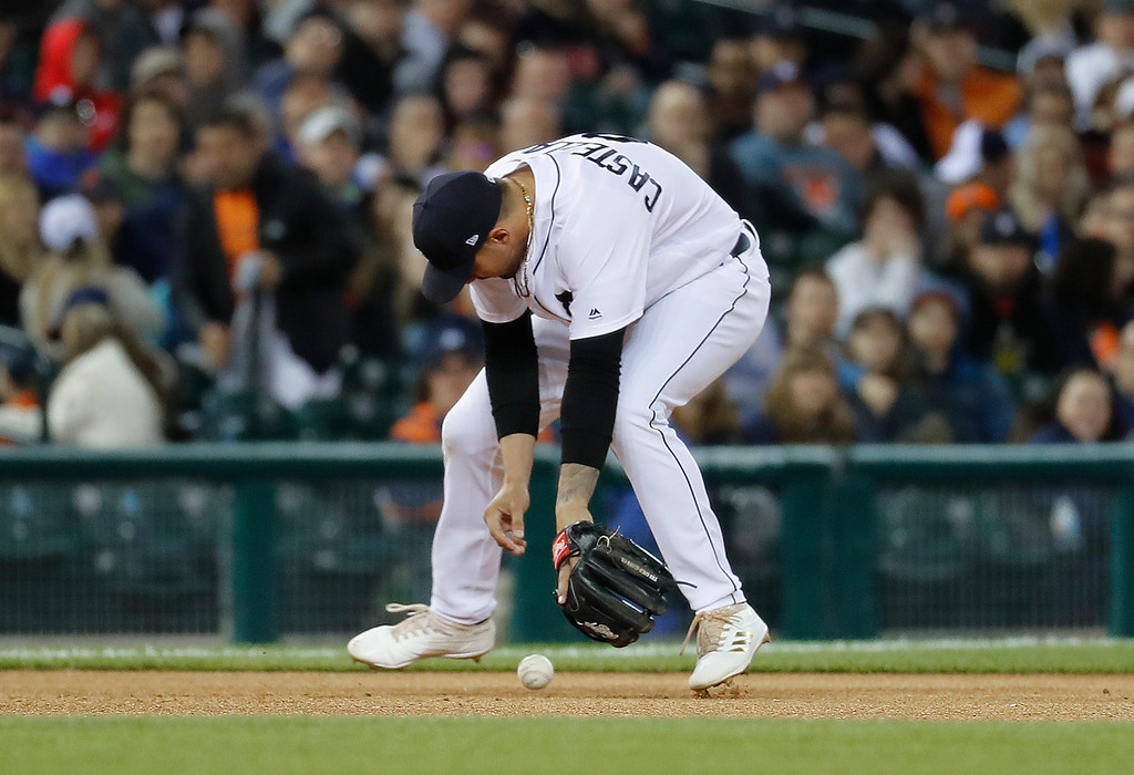 . Detroit Tigers third baseman Nicholas Castellanos (9) bobbles a Chicago White Sox\'s Todd Frazier ground ball in the eighth inning of a baseball game in Detroit, Friday, April 28, 2017. Castellanos was charged with an error on the play. (AP Photo/Paul Sancya)
