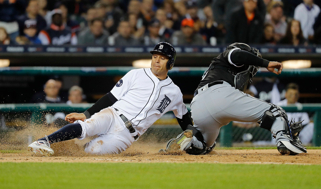 . Detroit Tigers\' Ian Kinsler slides safely into home plate to score as Chicago White Sox catcher Geovany Soto is late with the tag on a Victor Martinez single in the fifth inning of a baseball game in Detroit, Friday, April 28, 2017. (AP Photo/Paul Sancya)