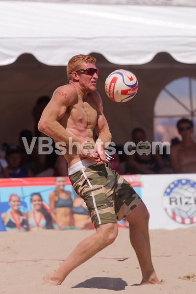 Skylar DelSol takes a spike to the right pectoral muscle.  If you look closely you can see the ball imprint.