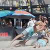 Nick Lucena vaults over Phil Dalhausser