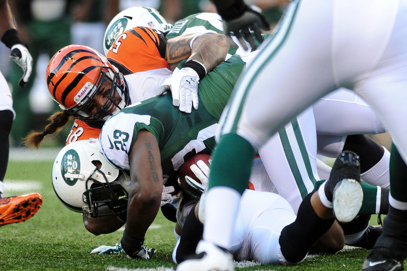 Cincinnati Bengals linebacker Rey Maualuga #58 tackles New York Jets running back Shonn Greene #23 during the game. The Cincinnati Bengals lead the New York jets 10 to 3 in the first half at Paul Brown Stadium in Cincinnati, Ohio.
