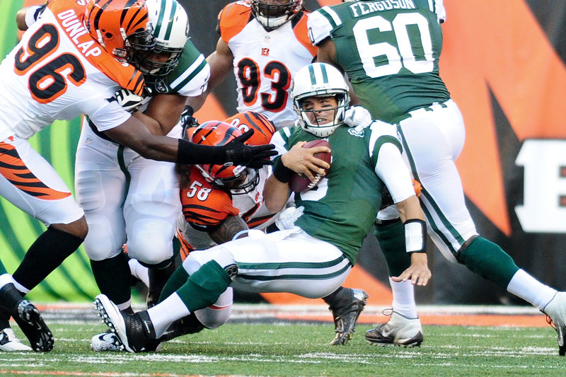 Cincinnati Bengals linebacker Rey Maualuga #58 sacks New York Jets quarterback Mark Sanchez #6. The Cincinnati Bengals lead the New York jets 10 to 3 in the first half at Paul Brown Stadium in Cincinnati, Ohio.