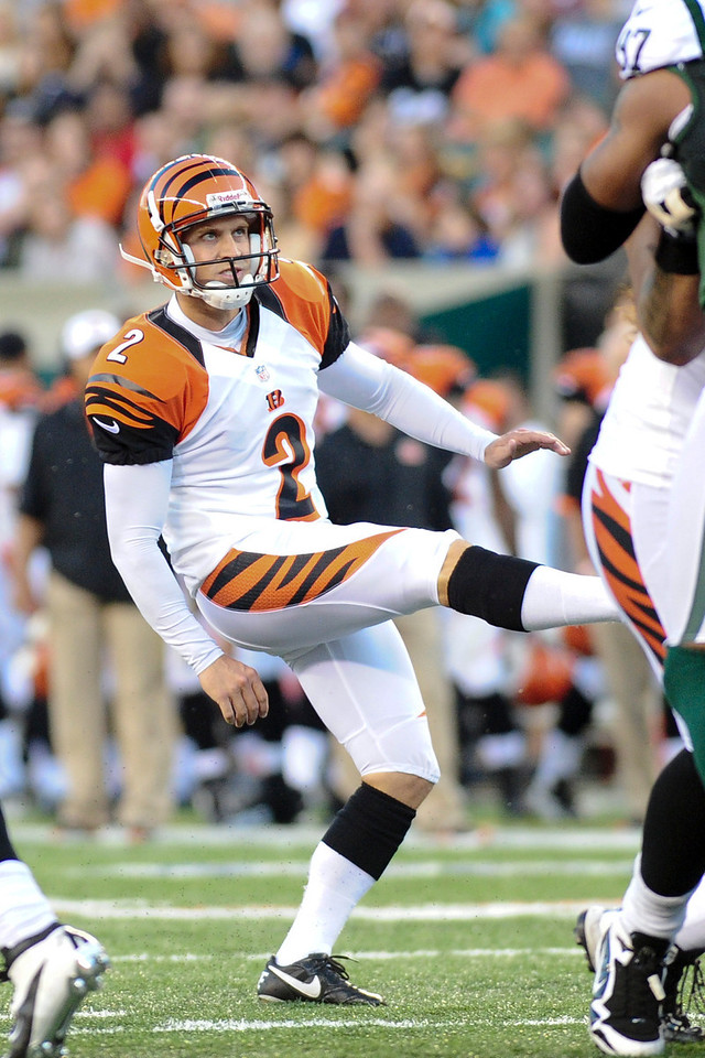 Cincinnati Bengals kicker Mike Nugent #2 looks up as the ball splits the upright during the game. The Cincinnati Bengals lead the New York jets 10 to 3 in the first half at Paul Brown Stadium in Cincinnati, Ohio.