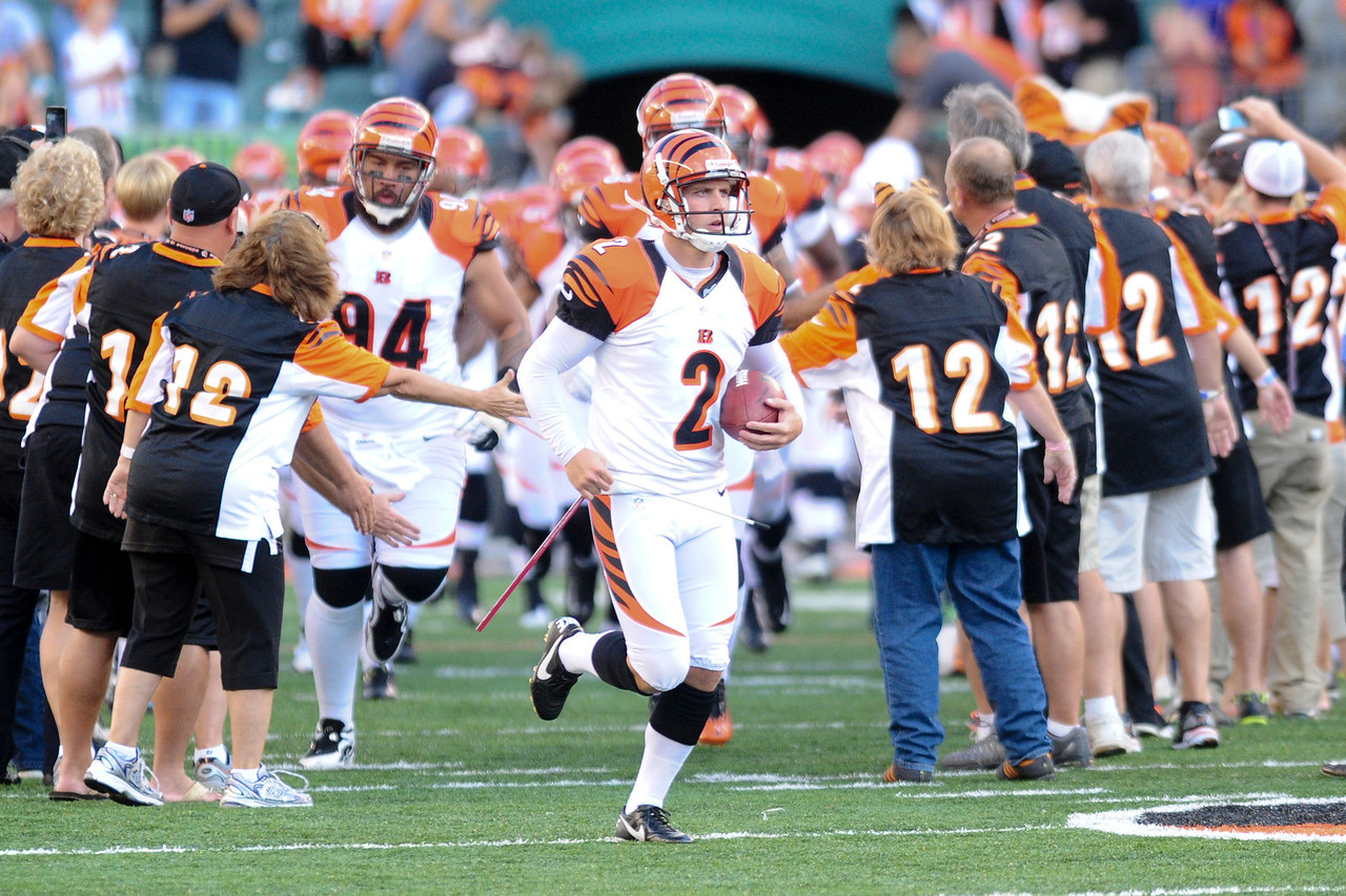Cincinnati Bengals kicker Mike Nugent #2 leads the team on the field before the game. The Cincinnati Bengals lead the New York jets 10 to 3 in the first half at Paul Brown Stadium in Cincinnati, Ohio.