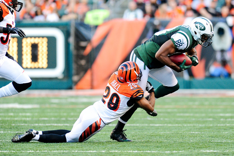 New York Jets wide receiver Patrick Turner #88 is stopped by Cincinnati Bengals defensive back Leon Hall #29 after making a reception. The Cincinnati Bengals lead the New York jets 10 to 3 in the first half at Paul Brown Stadium in Cincinnati, Ohio.