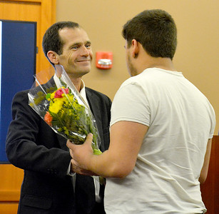 Effingham, Fayette, Clay and Jasper Problem-Solving Court graduate Trent Wilson presents flowers to his son to thank him for his support during the problem-solving court graduation ceremony Friday at the Effingham County Government Center. Kaitlin Cordes photo