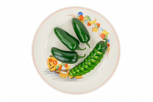 Jalapeno Peppers on Festive Mexican Plate.