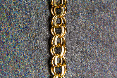 Macro of a gold chain.