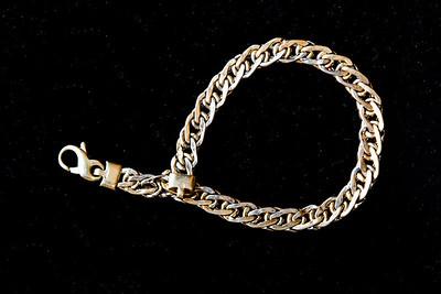 Gold wrist chain.