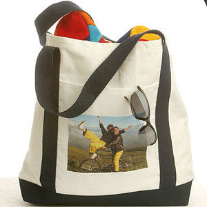 Photo tote bags are made from sturdy white canvas with navy blue bottom and straps. They are 14 inches deep by 19 inches wide.<br /> <br /> Your image is printed on the front pocket and measures approximately 7 inches wide by 5 inches high on the bag.<br /> <br /> Your photo must be at least 768 x 1100 pixels in size.<br /> <br /> Photo reproduction is good but not as accurate as photographic prints.