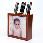 "Beautiful desk organizer, made of solid mahogany. Three sections to hold your pens, pencils and other office items.<br /> <br /> Your 4.25"" by 4.25"" square image (or cropped portion of an image) is printed on ceramic tile and inlaid on the front of the organizer.<br /> <br /> Box dimensions: 5"" wide x 5"" high x 2"" deep<br /> <br /> Your photo must be at least 1000 x 1000 pixels in size. Color reproduction on the desk organizer is nearly as accurate as on photographic prints."