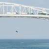 kite boarder blue water bridge