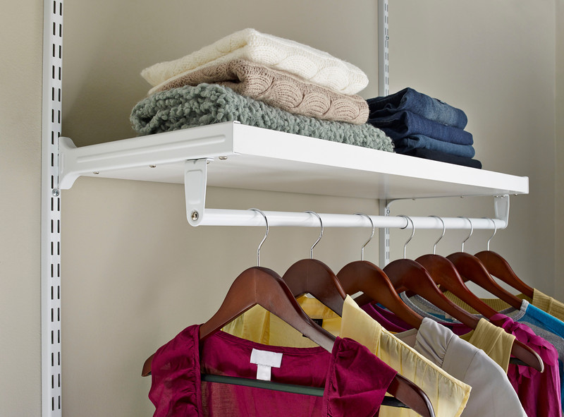 ClosetMaid ShelfTrack Elite shelf unit in White. Shelves come in 2 ft. and 3 ft. lengths are made of light, yet durable, honeycomb construction. ShelfTrack Elite works on an adjustable mounting system, which makes it easy to reconfigure the  shelves and other accessories as needs change.  Available through ClosetMaid Authorized Dealers.  ShelfTrack Elite also comes in a Chocolate finish.