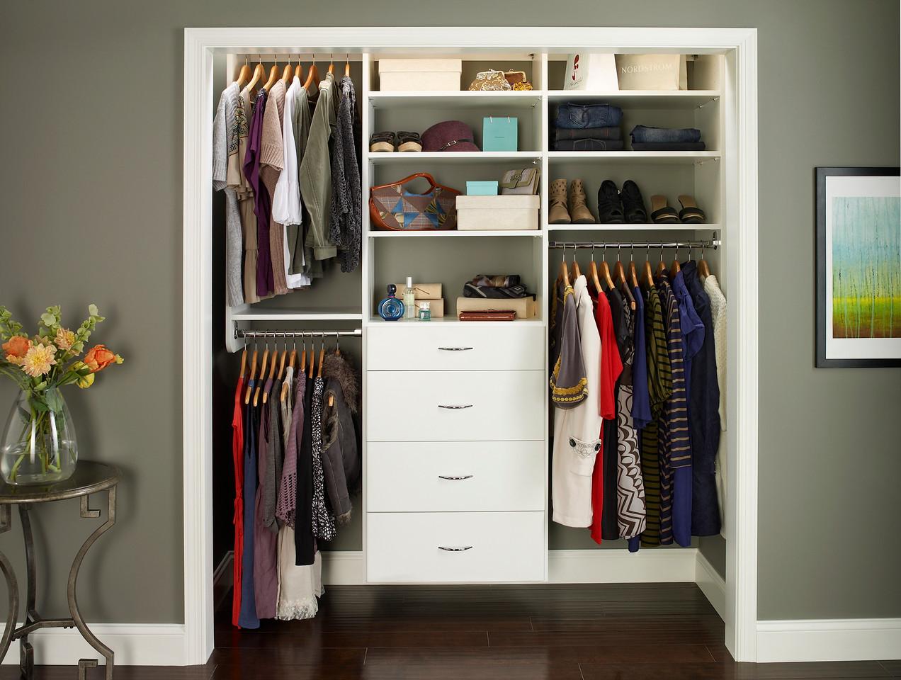 Reach-in closet featuring ClosetMaid MasterSuite in White