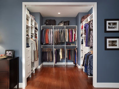Master bedroom walk-in closet featuring ClosetMaid MasterSuite in White