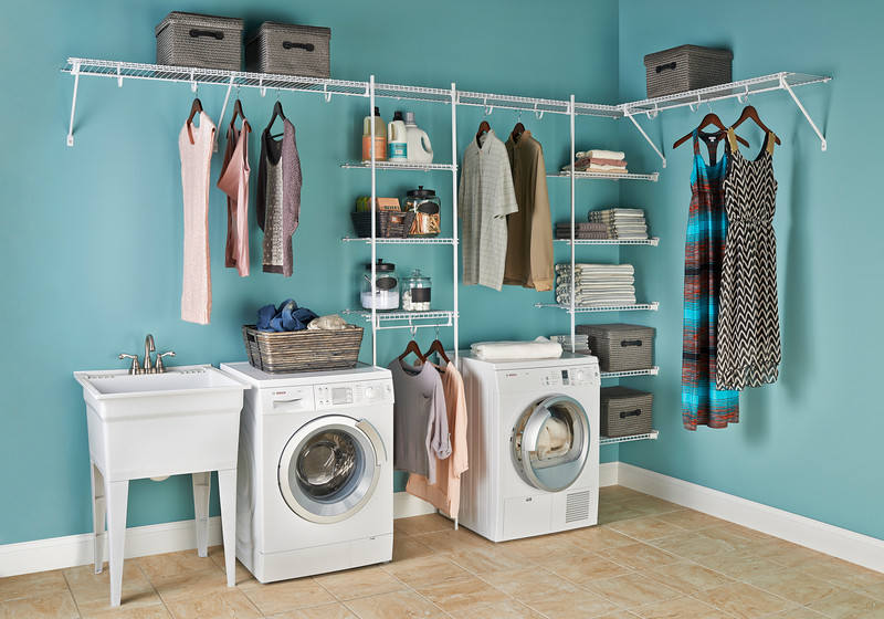 Laundry room featuring ClosetMaid wire shelving with TotalSlide Pro.  TotalSlide Pro easily attaches to standard wire shelves and provides continuous slide for hangers.