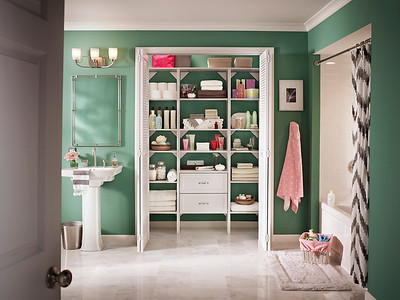Bathroom linen closet using ClosetMaid's DIY Laminate Shelving in White