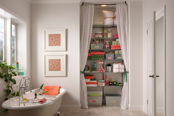 Bathroom linen closet using ClosetMaid ShelfTrack in Nickel