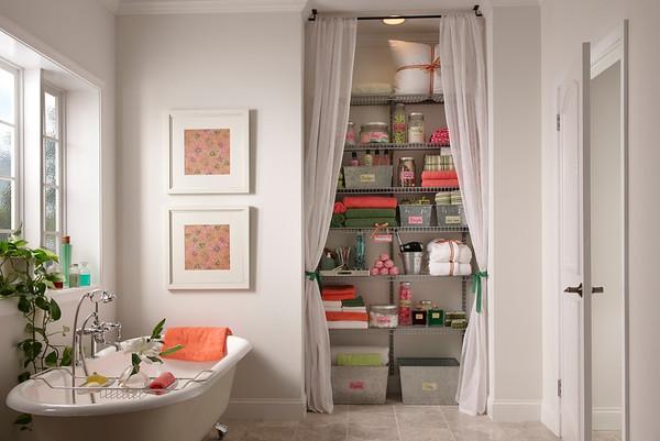 Bathroom linen closet using ClosetMaid ShelfTrack in Nickel