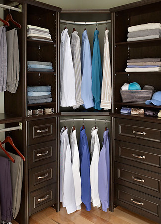Closet featuring Impressions towers and corner units with corner rounder bars.  Shown in Chocolate; also available in Dark Cherry.