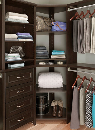 Closet featuring Impressions tower and corner units in Chocolate; also available in Dark Cherry.
