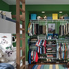 Reach-in closet featuring ClosetMaid ShelfTrack, an adjustable mounting system.