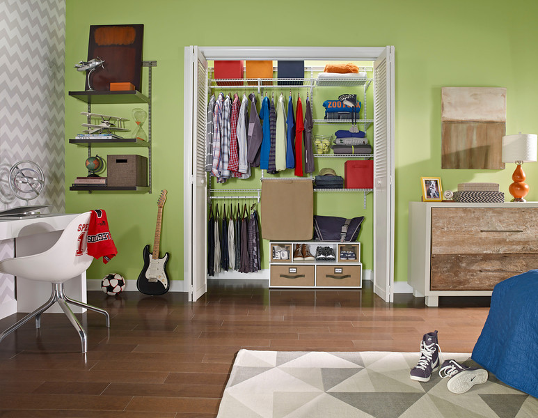 Closet featuring ClosetMaid ShelfTrack with canvas hamper and a Floor Organizer. Add additional storage outside of the closet with a ShelfTrack Elite Bookshelf Kit.