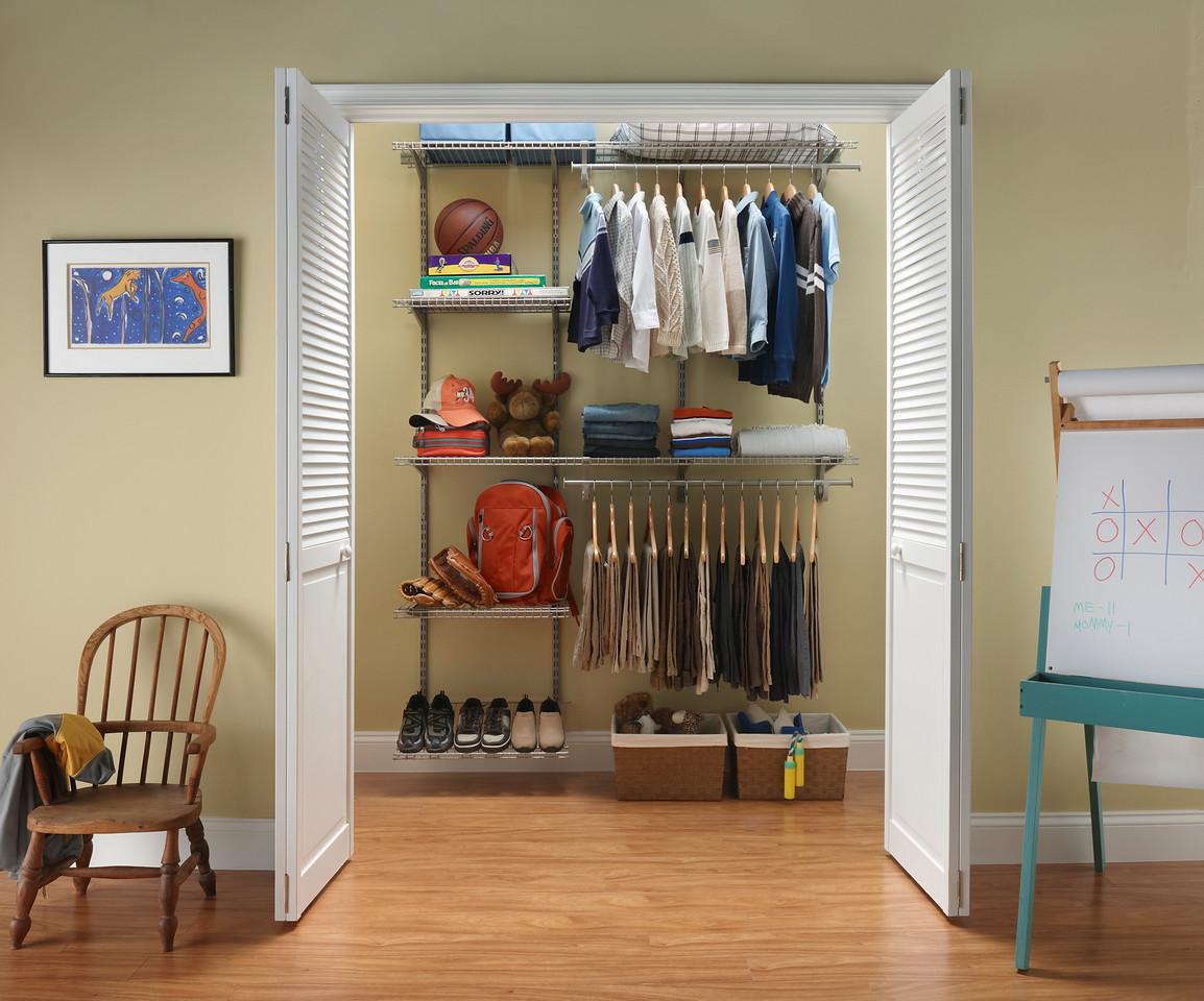Boy's reach-in closet using ClosetMaid ShelfTrack in Nickel