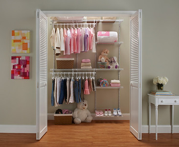 Girl's reach-in closet using ClosetMaid ShelfTrack in White