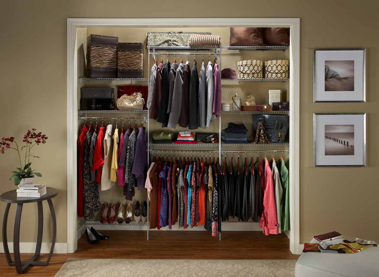 Reach-in closet using ClosetMaid wire shelving in Satin Chrome