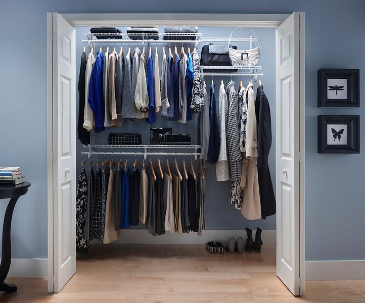 Reach-in closet using ClosetMaid ShelfTrack in White