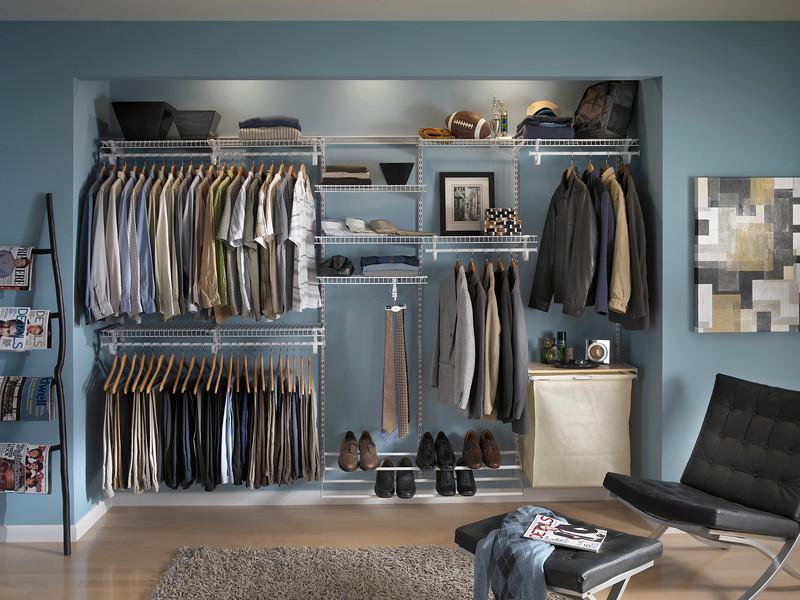 Reach-in closet featuring ClosetMaid ShelfTrack in White
