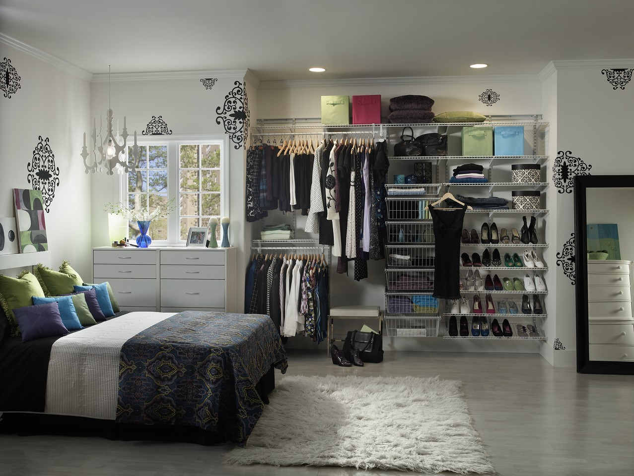 Reach-in closet featuring ClosetMaid ShelfTrack, pull-out baskets and shoe shelves in White