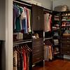 Master bedroom closet with ClosetMaid DIY Laminate Shelving in Espresso