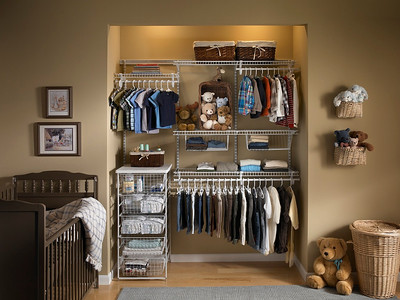 Nursery reach-in closet with ClosetMaid ShelfTrack in White