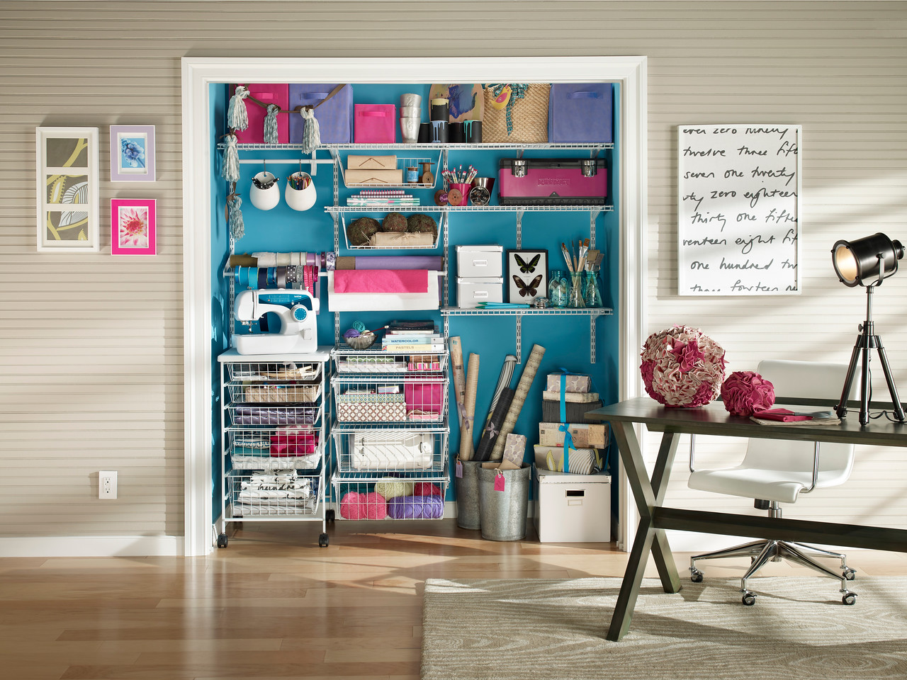Craft closet with ShelfTrack wire shelving and mobile 5-drawer cart in white.
