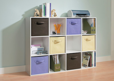 ClosetMaid Cubeicals 12-Cube Organizer in White with Fabric Drawers in Light Purple, Canteen and Natural.