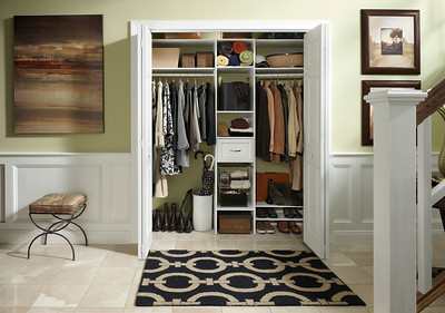 Hall closet featuring ClosetMaid DIY Laminate Shelving in White