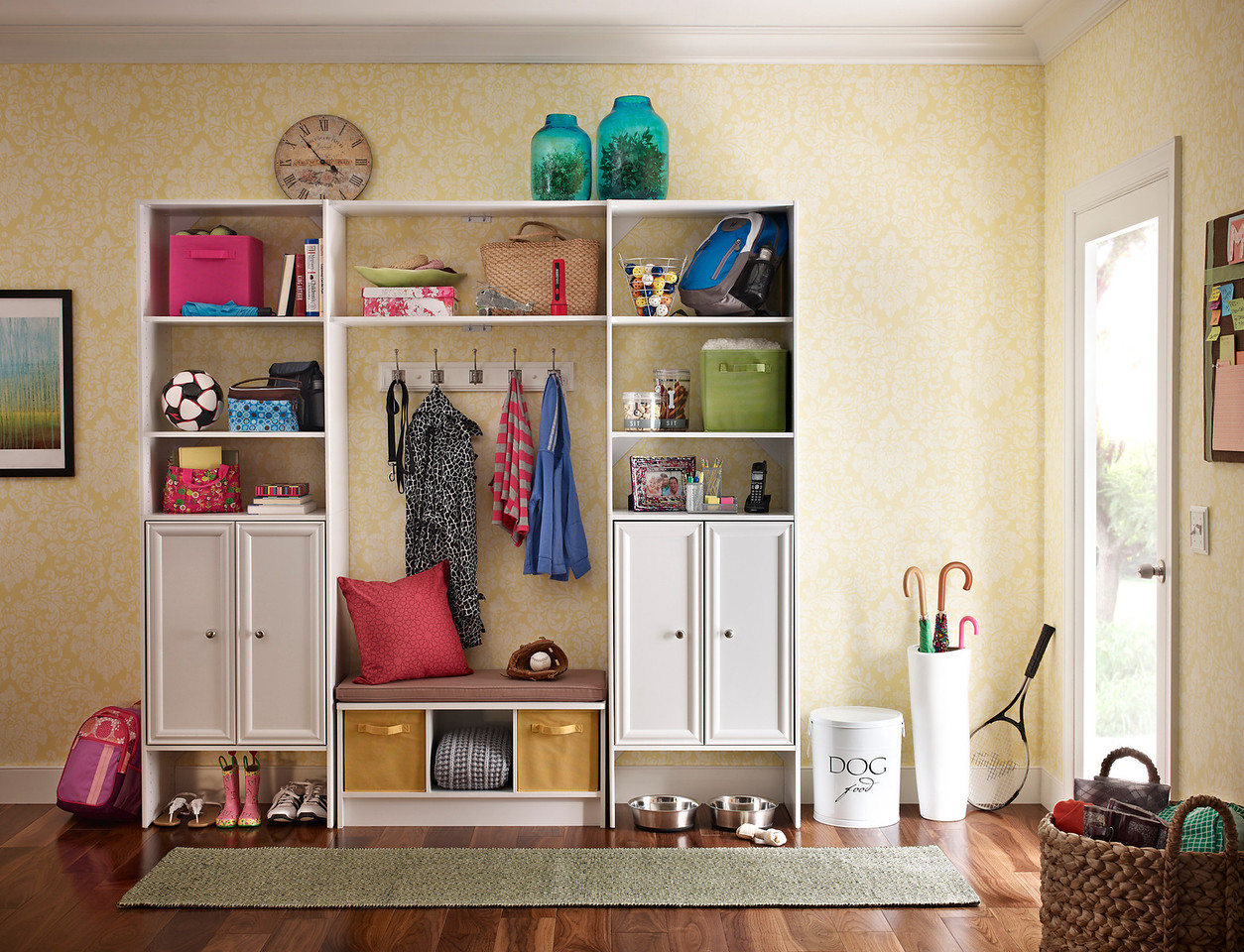 Mudroom storage area created with ClosetMaid DIY Laminate Shelving and a Cubeicals 3-Cube Storage Bench in White