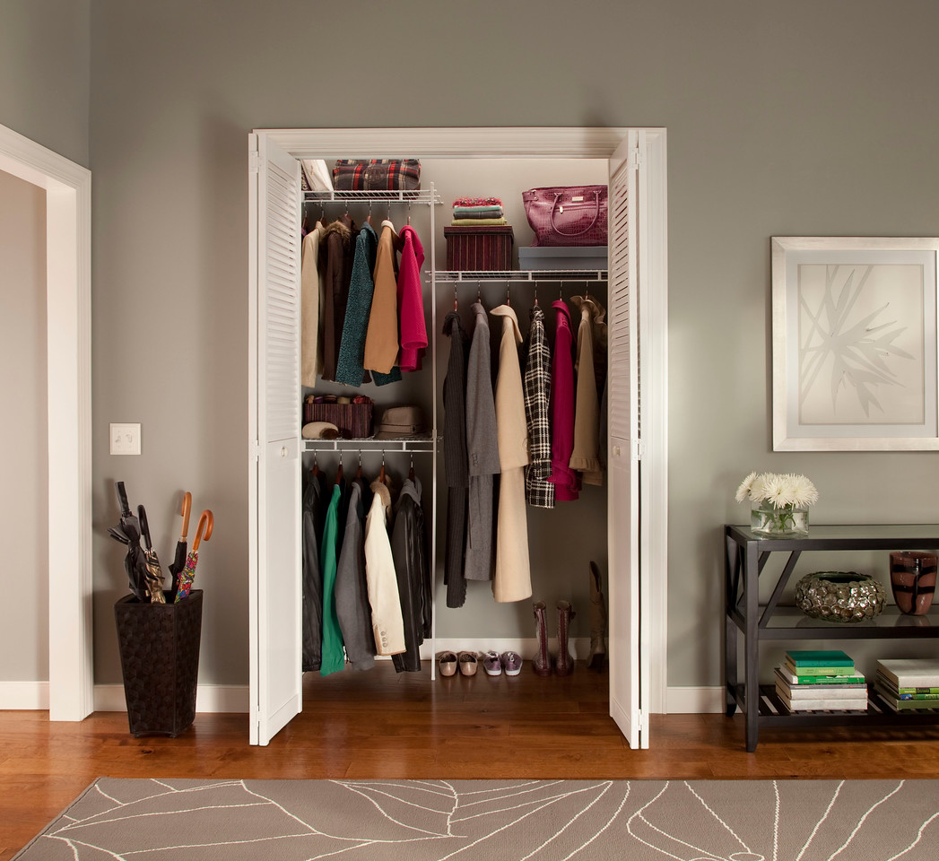 Hall closet featuring ClosetMaid fixed-mount wire shelving